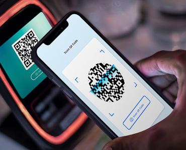 scanning QR code using mobile phone - digital society
